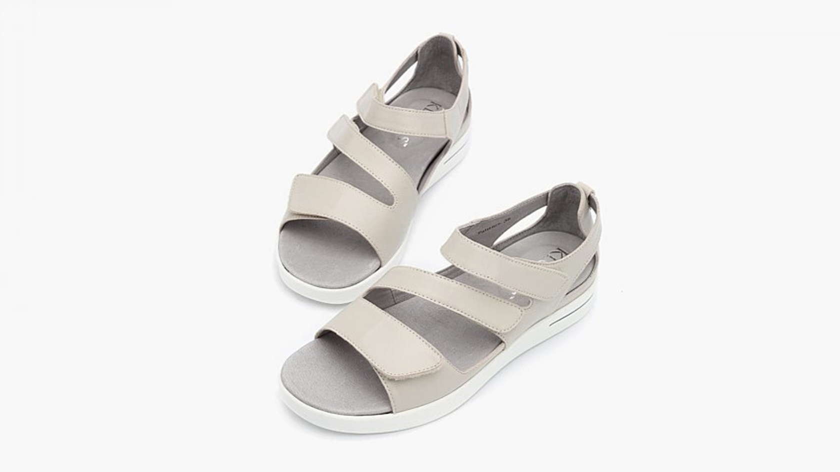 Pair of Taupe Patience sandals on a white background